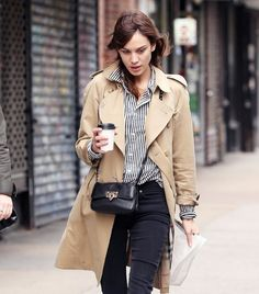 Black and white striped button-up blouse (tucked in), black skinny jeans, khaki trench coat