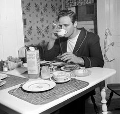 Marlon Brando eating breakfast and smoking, Delicious! 1947.