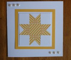 handmade Quilted card by Carolynn ... luv how the striped paper is arranged in this pieced star ...