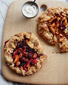 Plum-Blackberry and Peach Raspberry Galettes - A rustic galette makes you feel like a hero, though it's really one of the most forgiving desserts you could possibly put together. Any combination of stone fruit and berries tossed with sugar, butter, and a squeeze of lemon yields delicious results.