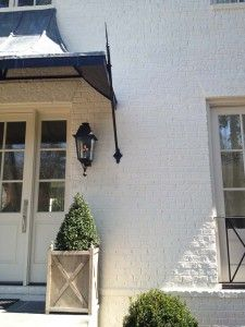 Brick home painted with ROMA's BioCalce (limewash) to create a finish that looked established, not newly constructed.