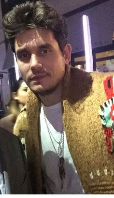 Only he can wear a Mr. Rogers sweater and still look hot! ❤