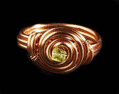 Copper wire wrapped swirl ring with peridot by RadFabrications, $15.00