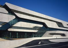 """Architecture: Pierres Vives by Zaha Hadid Architects: """"..Zaha Hadidhas completed a streamlined concrete and glass building for three government departments inMontpellier, France..ThePierres Vives Buildingwill accommodate the multimedia library, public archive and sports department of theHerault regional government and is due to be inaugurated on 13September..A recessed section of green-tinted glass runs along the length of the facade, where a first-floor foyer connectsthe library and…"""