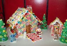 Gingerbread house with ice cream cone trees cover in colored coconut and used Pez for brick walkway, mini house made from graham crackers Brick Walkway, Cone Trees, House Made, Winter Fun, Gingerbread, Decorating Ideas, Coconut, Ice Cream, Cover
