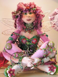 June was based on a pattern in Patti Medaris Culea's book 'Creative Cloth Doll Making' by Claire