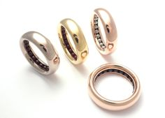 Sean O'Connell precious metal and gemstone ball bearing rings.