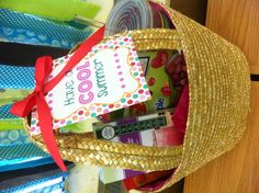 "Have a ""Cool"" summer gift basket idea: reusable tumbler, bottled cocktail (or mocktail), lemonade mix, Snapple flavored Jelly Belly candy, Godiva chocolate covered strawberries, straw bag from Target's dollar bin"