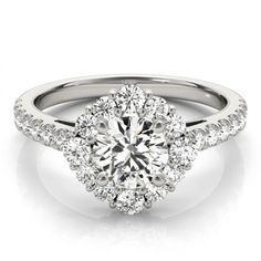 Uniquely Set Square Halo with a Round Diamond Center Engagement Ring.