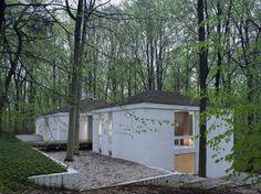 House on the hill, gravel yard, raised walkway