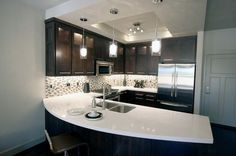 quartz countertop - like the dark cabinets with it Kitchen Design Trends  www.OakvilleRealEstateOnline.com