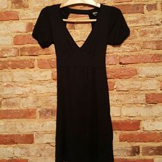 Guess black dress Adorable black dress size small with open back and tie in back. Excellent condition Guess Dresses