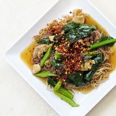 Thai rice noodle with chicken and Chinese kale in yellow bean sauce