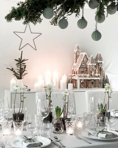 Image may contain: table, plant and indoor Christmas Table Settings, Christmas Decorations, Table Decorations, Christmas Inspiration, Winter Christmas, Indoor, Photo And Video, Furniture, Olsen
