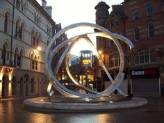 """Belfast - Spirit of Belfast [aka the """"Onion Rings""""] Arthur Sq - Corn Market - Sculpture by Dan George. Northern Ireland. On site of the old bandstand."""