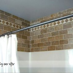 Bathroom DIY - tile looks beautiful above the tub/shower combo