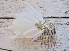 """50 Unique Wedding Hair Accessories From Etsy: The beach bride could add seashell bobby pins ($25) to her cascading waves. : Forgo a traditional veil with this bridal flower headband ($120). : A nontraditional bride should go for something playful like a peacock hair comb ($25), which could also serve as your """"something blue."""" : This pair of love-bird bobby pins ($32) lends a romantic touch. : A bridal ivory birdcage veil headband ($45) is simple and sweet, and makes the loveliest accent for…"""