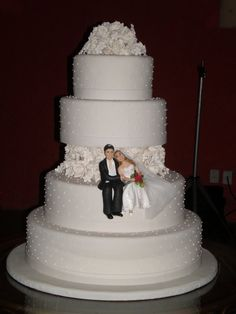 Detalhe da imagem de —Ideias de Mulher: Topo para bolos de casamento