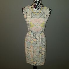 Chic Happens Shift Dress This stunning geometric pattern offers a chic update to the classic shift dress. Pair with nude heels for a dainty look Or up the anty with a bold neon heel.  Hidden zipper with hook eye closure.  Fully Lined.  100 % Rayon Dry clean only.  Runs True to size 8. Dresses Midi