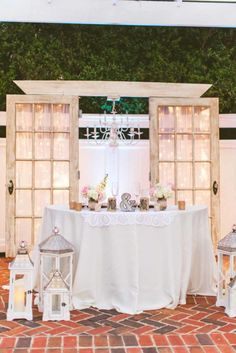 Old Doors with Chandelier for Sweetheart Table - Rustic Vintage Wedding - Photographer: Concept Photography - Cypress Grove Estate House - Orlando Florida Wedding Venue - Click pin for more - www.orangeblossombride.com