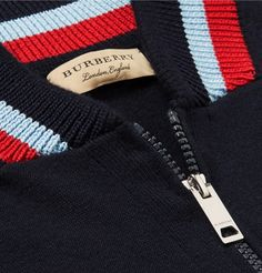 <a href='http://www.mrporter.com/mens/Designers/Burberry'>Burberry</a>'s zip-up sweater combines the cozy feel of a cardigan with the cool look of a bomber jacket. Knitted from soft cashmere, it has sporty striped trims and a sleek gunmetal fastening. Wear yours at the weekend over a simple tee or collared shirt.