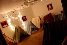 Camp themed birthday party - tents were made from simple pieces of wood and twin sized sheets!