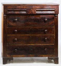 Lot 68: Empire Burled Walnut Chest of Drawers; Having double top drawers with small center drawer over four full drawers