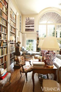 """From the front door, I could immediately see right into the living room and out that big, beautiful window, all the way to the backyard,"" Moss says. ""I thought it was the antidote to city living. City Living, Living Area, Living Spaces, Living Room, Beautiful Interiors, Beautiful Homes, Beautiful Library, Dream Library, Grand Library"