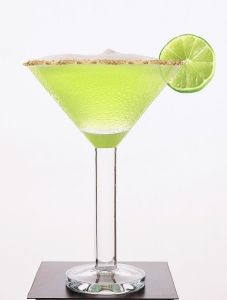 Key Lime Martini Key Lime Martini 2 parts Absolut™ Vanilla 1 part Midori 1/2 part pineapple juice 1/2 part sweet lime juice Combine all ingredients over ice, and shake vigorously. Strain into a graham cracker-rimmed martini glass, and garnish with a lime slice.