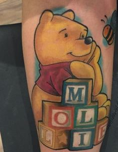 What does winnie the pooh tattoo mean? We have winnie the pooh tattoo ideas, designs, symbolism and we explain the meaning behind the tattoo. Winnie The Pooh Tattoos, Winnie The Pooh Friends, Tattoo For Baby Girl, Baby Name Tattoos, Grandchildren Tattoos, Amazing Meaning, Baby Footprint Tattoo, Most Popular Cartoons, Flower Tat