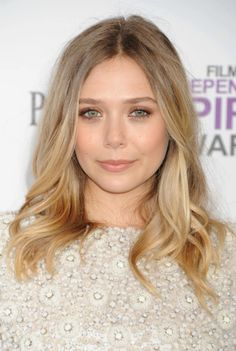 "Want to get ""undone"" waves like Elizabeth Olsen?    Here's what Dove hairstylist Mark Townsend did to Olsen's hair: 1) moussed her damp strands, 2) scrunched hair while blowdrying, 3) created loose waves by wrapping sections vertically around a curling iron, 4) lightly sprayed her hair with texturizing spray (Oribe Dry Texture Spray) and 5) hairsprayed all over while scrunching again (flexible hold kind).  Seems simple enough, but you know it'll never really look as good as hers lol."