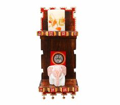 Hand painted stand with flaps. Made from mango wood. Adorned by a warli artwork. This piece will add sheen to your house.