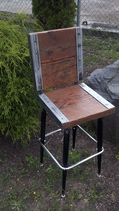 EXPENSIVE: ($175 each) but love the look of these for the bar. Etsy listing at http://www.etsy.com/listing/153970843/industrial-stool-with-back-made-with-old