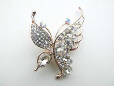 Broche vlinder vol met steentjes.