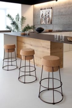 Love these unique stools and the mix of concrete and wood in the room