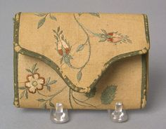 """Pennsylvania silk on linen pocketbook wrought by Sarah Mendenhall, late 18th c., with initials and trailing floral vine, 4 1/2"""" w. An early written note discussing this pocketbook accompanies the lot."""