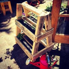 handmade wooden pallet A-frame planter with wheels