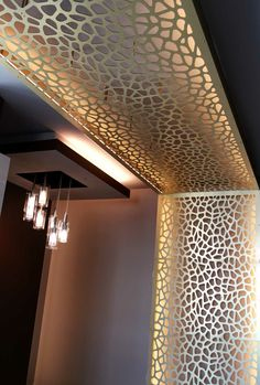 CNC screen walls and ceiling. Gold aluminum composite panels, CELL pattern.