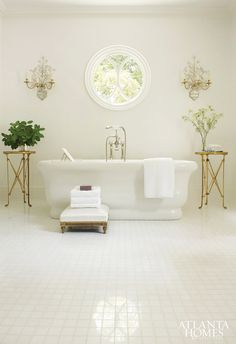 elegant monochromatic bathroom w/antique brass accents