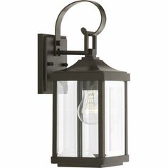 Progress Lighting Gibbes Street H Antique Bronze Medium Base Outdoor Wall Light at Lowe's. Elongated frames capture the romantic charm of vintage gas lanterns. Inspired by a stroll down a Charlestonian street bearing the same name, the Gibbes Outdoor Wall Lantern, Outdoor Wall Sconce, Outdoor Wall Lighting, Outdoor Walls, Club Lighting, Exterior Lighting, Lighting Ideas, Gas Lanterns, Hanging Lanterns