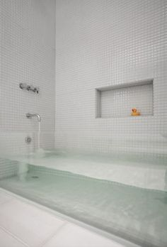 Glass bath tub. Take your bathroom to a whole new level with a low glass panel that contains the water. Tiled floors and walls and a secure glass installation makes it completely waterproof and sturdy.