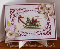 Christmas Rose and Candles. For this card I used ruby red and white cardstock, a spellbinders frame die an embossing folder, a small flower die to make the Christmas rose and leaves, a candle die, I also used some distress inks and a little glitter.