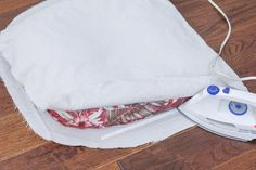 Update old patio cushion covers with a canvas drop cloth -- no sewing required! As an added bonus, these are removable and washable. Recover Patio Cushions, Patio Cushion Covers, Patio Furniture Cushions, Diy Cushion, Diy Outdoor Furniture, Seat Cushions, Furniture Ideas, Furniture Layout, Pallet Furniture