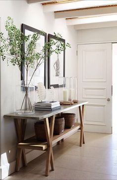 traditional entryway, modern entryway, large art entry way, large table entry, large plants entry