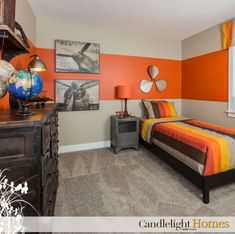 I like this light carpet, dark furniture and the large stripe of orange. It's enough without being overbearing with stripes. Teen boy room win!