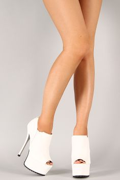 Keep your style unique with these platform booties! Featuring leatherette upper, peep toe front, wrapped platform and stiletto heel, textured platform, elasticized paneling at top, rear zip closure for easy on/off, and finished with lightly padded insole for comfort.