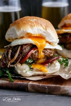Drunken Aussie Beef Burgers ~ gets a drunken make over with a beer spiked juicy beef burger patty, layered with crispy bacon, caramelized pineapple, melted cheese, fried onion rings, sweet beetroot, ripened tomatoes and the most amazing egg and burger porn to hit your kitchen bench
