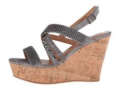 I promise you cannot go wrong with these wedges! They match with everything! Elevate your summery-chic style in the Not Rated? Viti platform wedge. Man-made upper with jeweled details. Slingback strap with buckle closure. Open-toe silhouette. Man-made lining. Lightly padded footbed. Wrapped cork platform wedge. Find these blingy pewter grey wedges at Jourdan's Jewels.