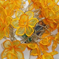 Looking for your next project? You're going to love 3D Daffodil String Light Pattern by designer Embroidershoppe.