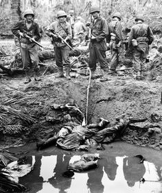 US troops checking the dead Japs. The Battle of Leyte.